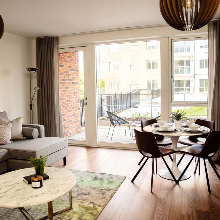 luxury living space, dining area and balcony in furnished apartment